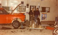 Straightening the 404's steering arm in a garage. Richard Davies pic (Car 52 - Richard Davies, Richard Williamson/Mark Huntley).