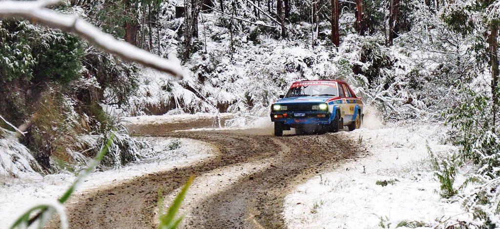 Rally car on a snowy track.